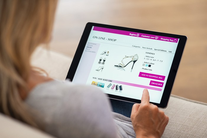 Woman using a tablet to shop for shoes online
