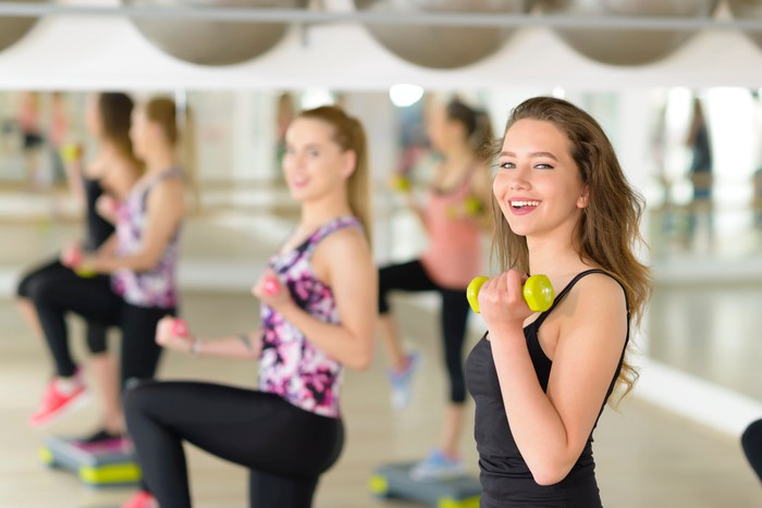 Teenagers exercising at a gym