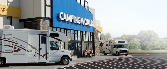 Camping World storefront with two RVs parked outside.