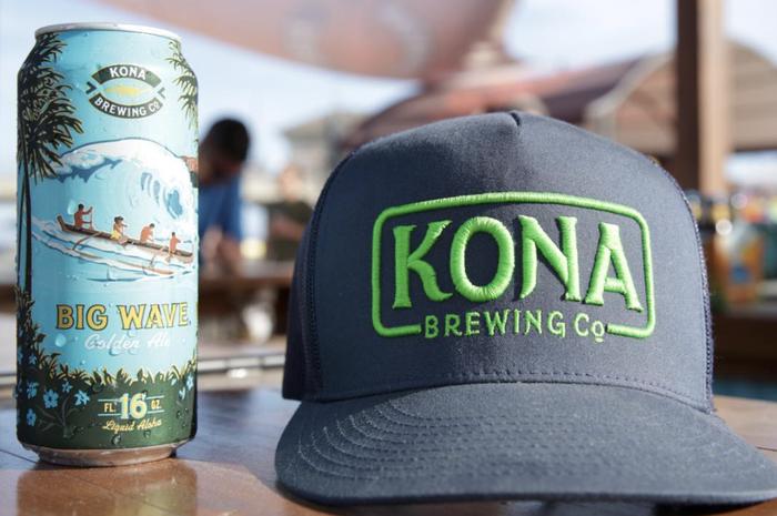 Can of Kona beer and trucker hat