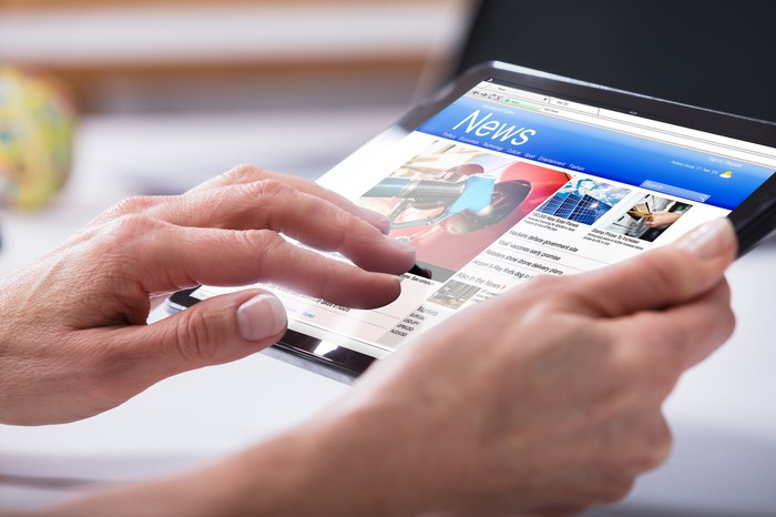 Woman reading news on a tablet