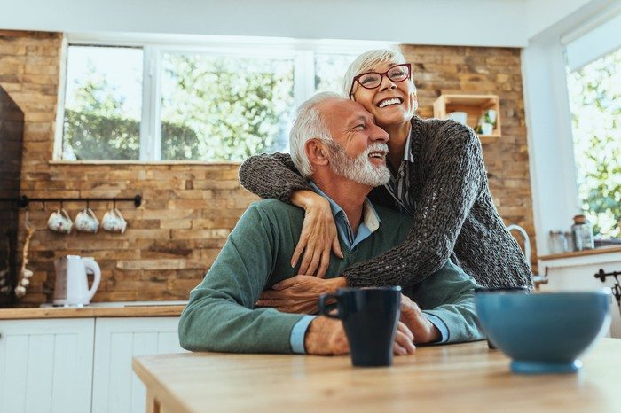Smiling older man and woman embracing