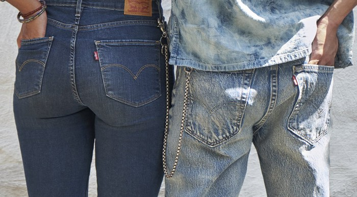 Two people where Jeans. One shows a Levi's Red Tab.