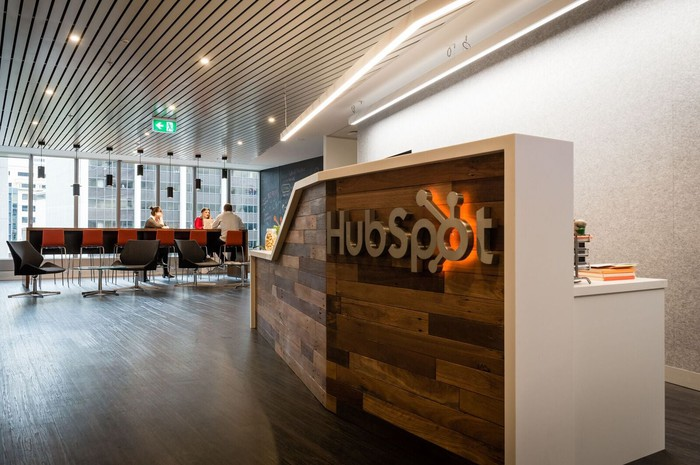 A reception desk with the HubSpot logo on the front.