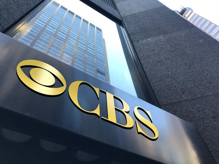 The CBS logo on the face of an office building.