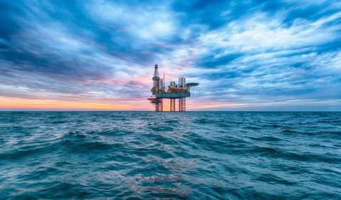 An offshore jackup rig at dusk.