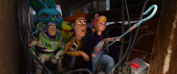 Buzz Lightyear, Sheriff Woody, and Bo Peep along with Ducky and Bunney in a scene from Toy Story 4.