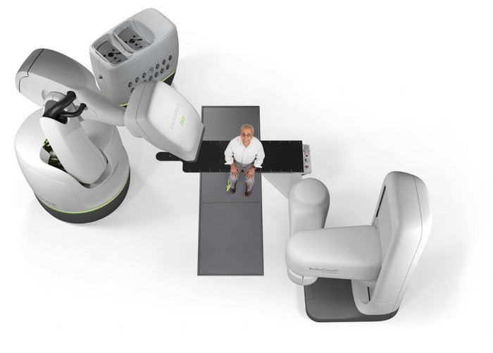 Accuray CyberKnife system with a man sitting in the middle