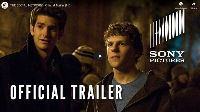 A photo of actors Andrew Garfield and Jesse Eisenberg in a screenshot of the official trailer for the 2010 movie The Social Network.