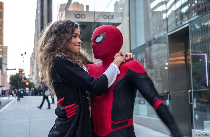 Spider-Man with his arm around MJ, in a scene from Spider-Man: Far From Home.