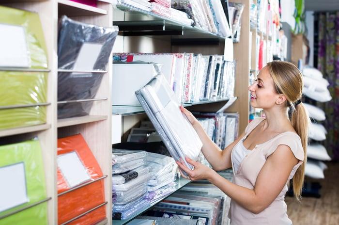 Woman shopping at a bedding retailer.