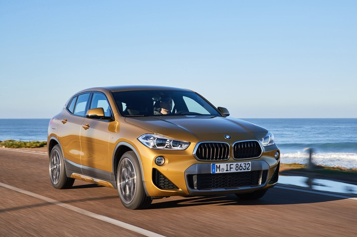 A 2020 BMW X2, a compact crossover SUV, on a coastal road.