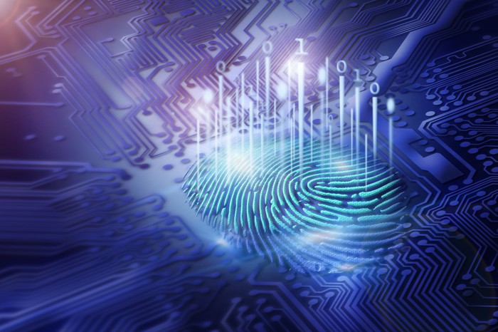A digital fingerprint surrounded by circuitry
