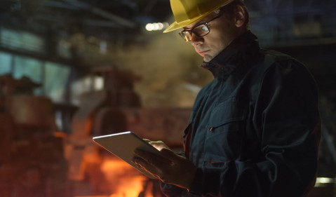 18_11_26 Man writing on notebook while standing in a steel mill_GettyImages-838527720