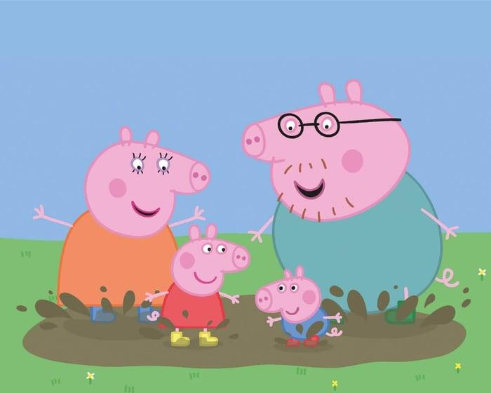 Peppa Pig characters play in mud.