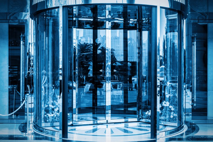 View from outside of a building's glass revolving doors.