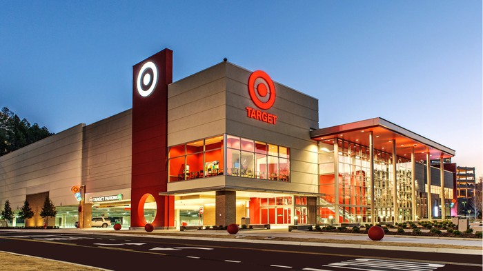 Exterior shot of a Target store illuminated against a darkening sky.