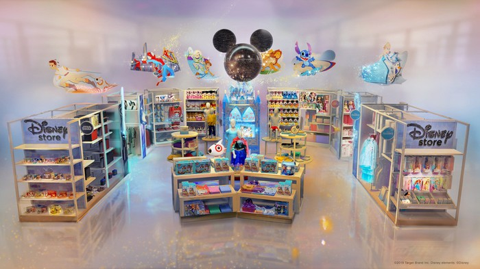 A small retail space adorned with Disney characters and Disney merchandise on the shelves, with a toy Target mascot dog peering from behind one of the shelves.