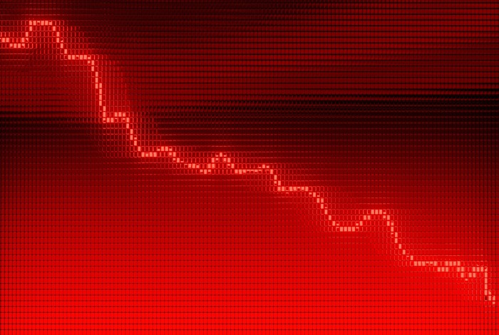 A declining stock chart on a red background.