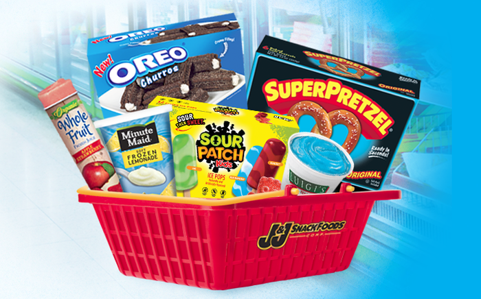 Red grocery store-type basket filled with various products made by the J&J Snack Foods, including SuperPretzel soft pretzels and Luigi's Real Italian Ice.