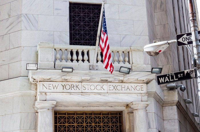 U.S. flag in front of the New York Stock Exchange.