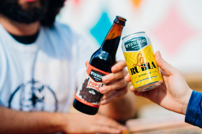 Bottle and can of Wynwood Brewings Pop's porter and La Rubia