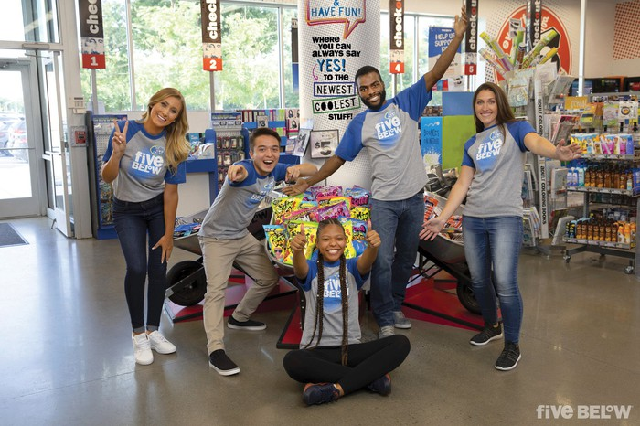 Four employees at a Five Below store