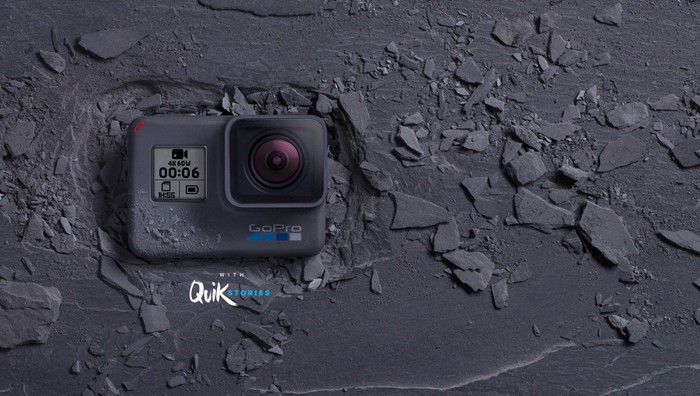 GoPro camera on a slate background.