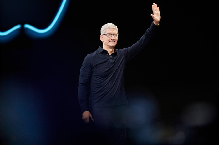Tim Cook on stage waving