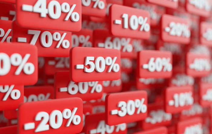 A 3D illustration shows a series of red, floating discount price tags.
