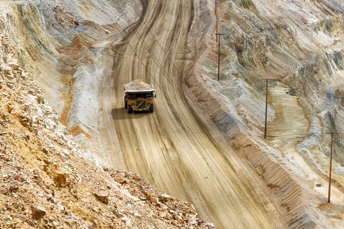 A large truck carrying ore from a mine.