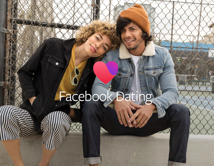 A young man sitting on a curb and a young woman resting her head on his shoulder with the caption Facebook Dating.