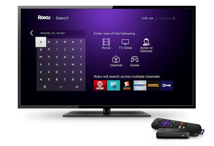 Roku streaming device next to a TV displaying the search section of the ROKU app.