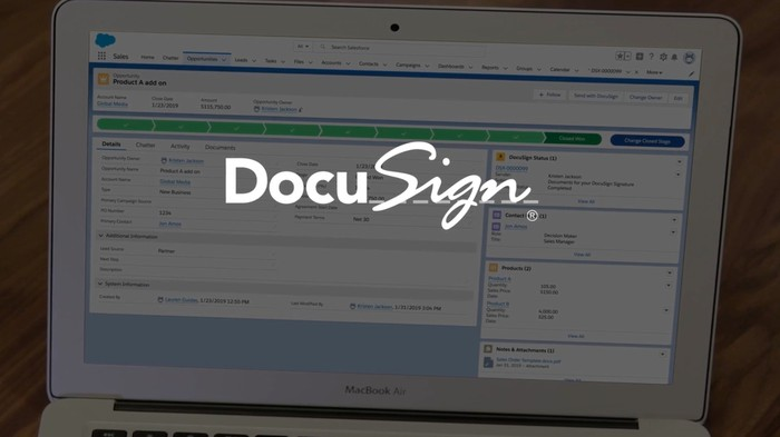 Laptop displaying DocuSign page with DocuSign logo superimposed.