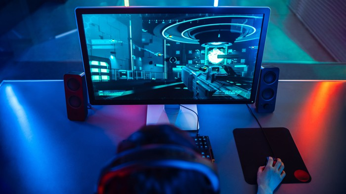 A person playing a video game on a PC.