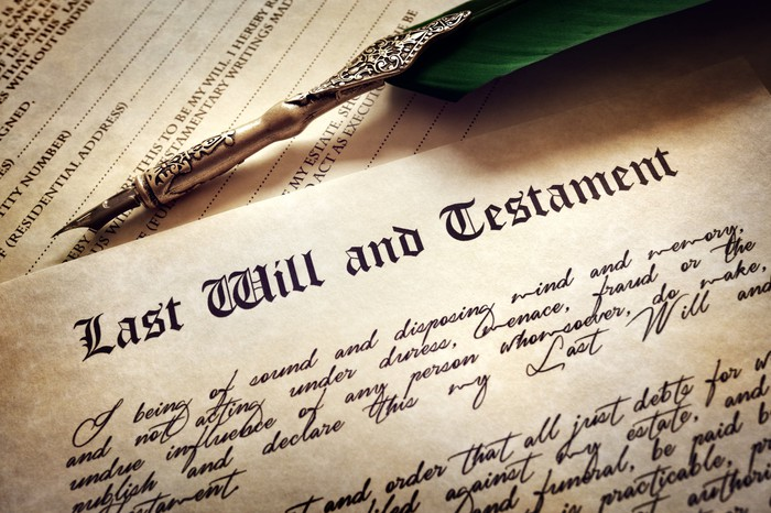 A last will and testament, with a pen above it.