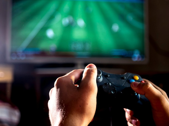 A person holding a game controller.
