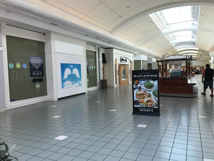 A mostly empty mall corridor at Moorestown Mall
