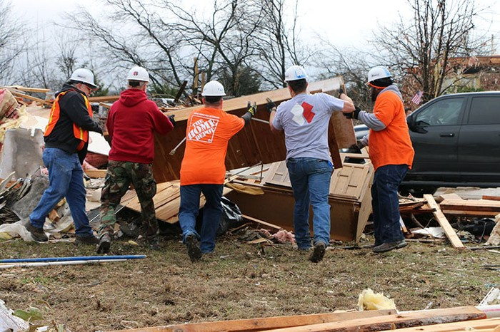 Home Depot employees aiding in a disaster relief effort following a storm.