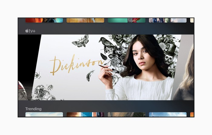 Actress Hailee Steinfeld holding a pencil and wearing a 19th-century dress in a promo for Apple's original series Dickinson.