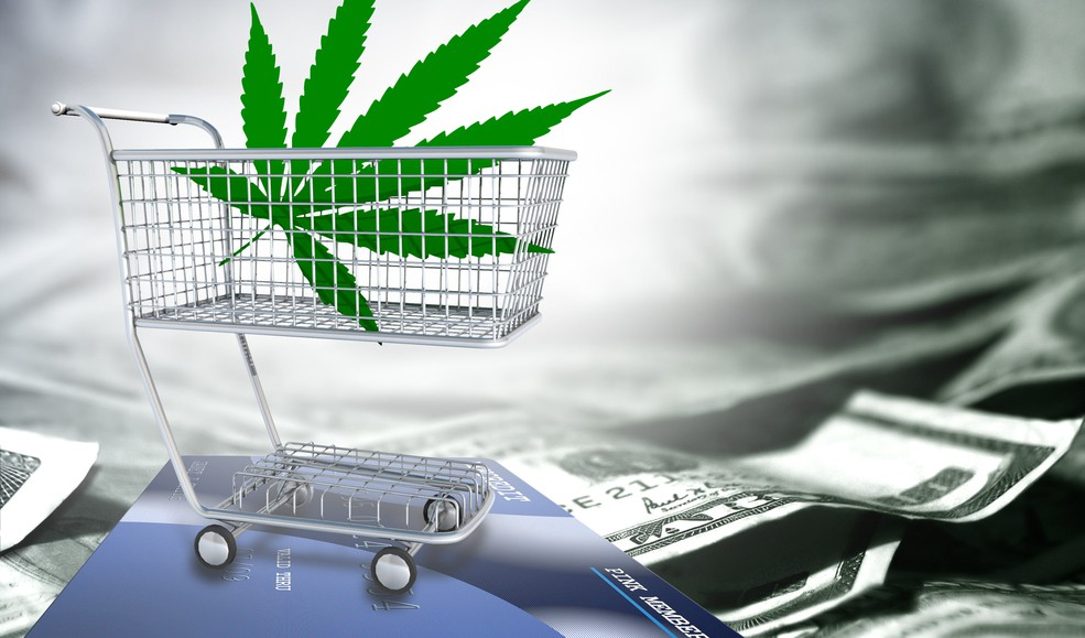 19_09_10 a marijuana leaf in a shopping cart over a credit card and cash_GettyImages-1011163448