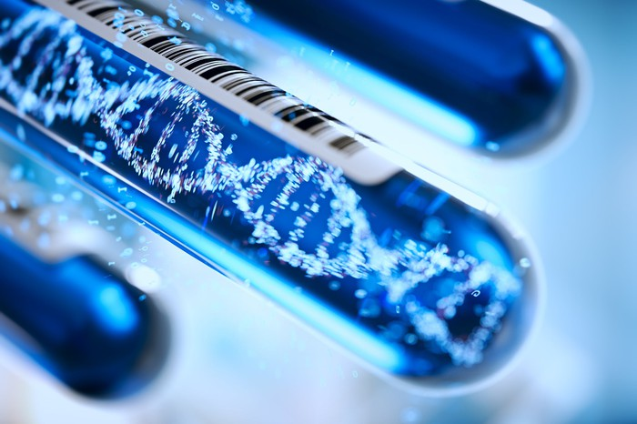 Test tubes with image of DNA helix inside one test tube