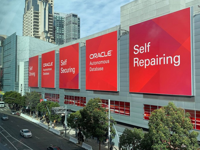 Large banners on the side of a building highlighting the Oracle OpenWorld event.