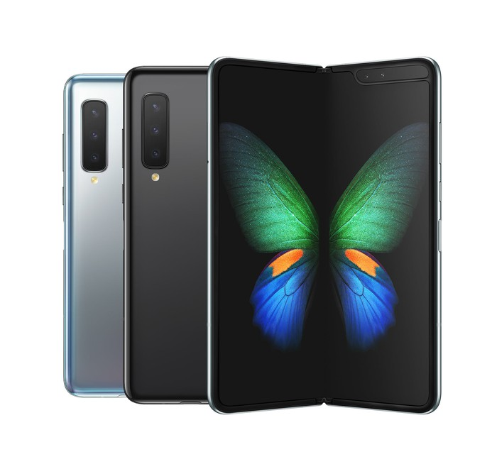 Three different colors of the Samsung Galaxy Fold with one opened to a butterfly background.