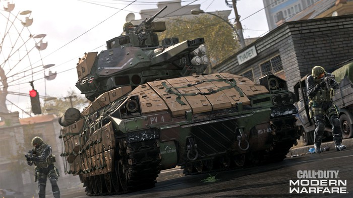 A tank driving in an urban area with soldiers flanking in a screenshot from Call of Duty Modern Warfare.