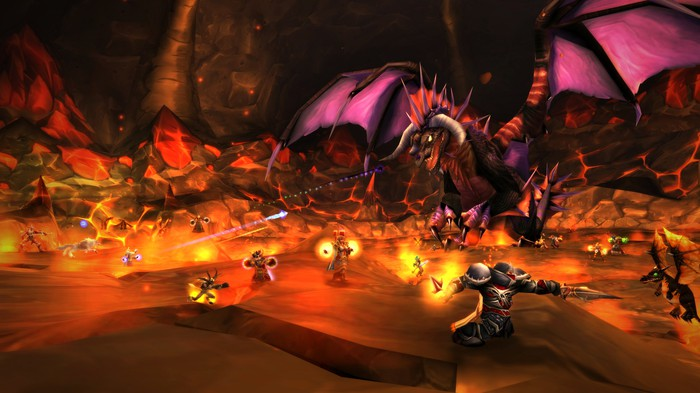 Animated characters battling a dragon in a screenshot from World of Warcraft Classic.
