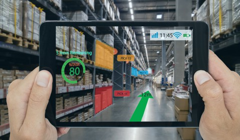 Factory Worker Using AR on Tablet