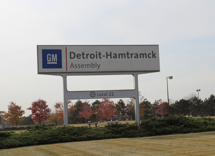 A sign outside GM's Detroit-Hamtramck Assembly Plant, one of several factories GM plans to idle to cut costs.