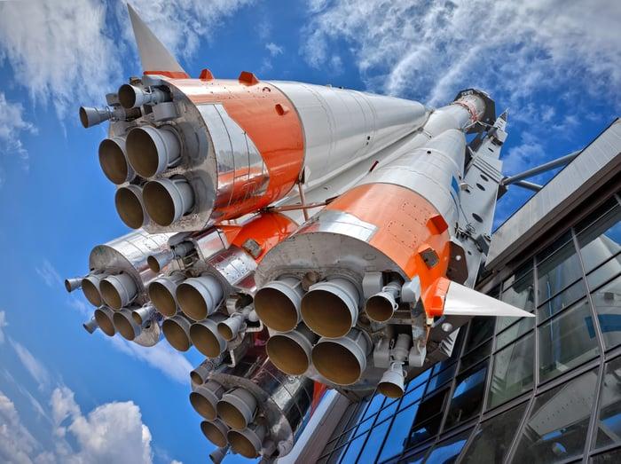 Big rocket pointing toward the sky.