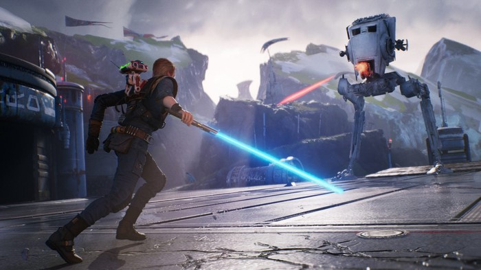 Screenshot from Electronic Arts' upcoming Star Wars game, with a character holding a lightsaber facing down a giant weaponized machine